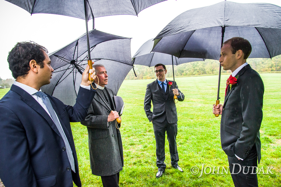 Mathieu waiting in the rain just before their ceremony begins on Celebrations grounds.